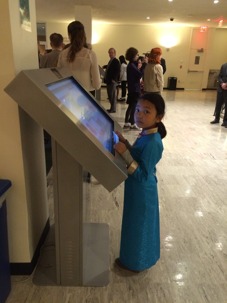 Viewing the Big Book pages on the kiosk at the UN, March 20, 2016